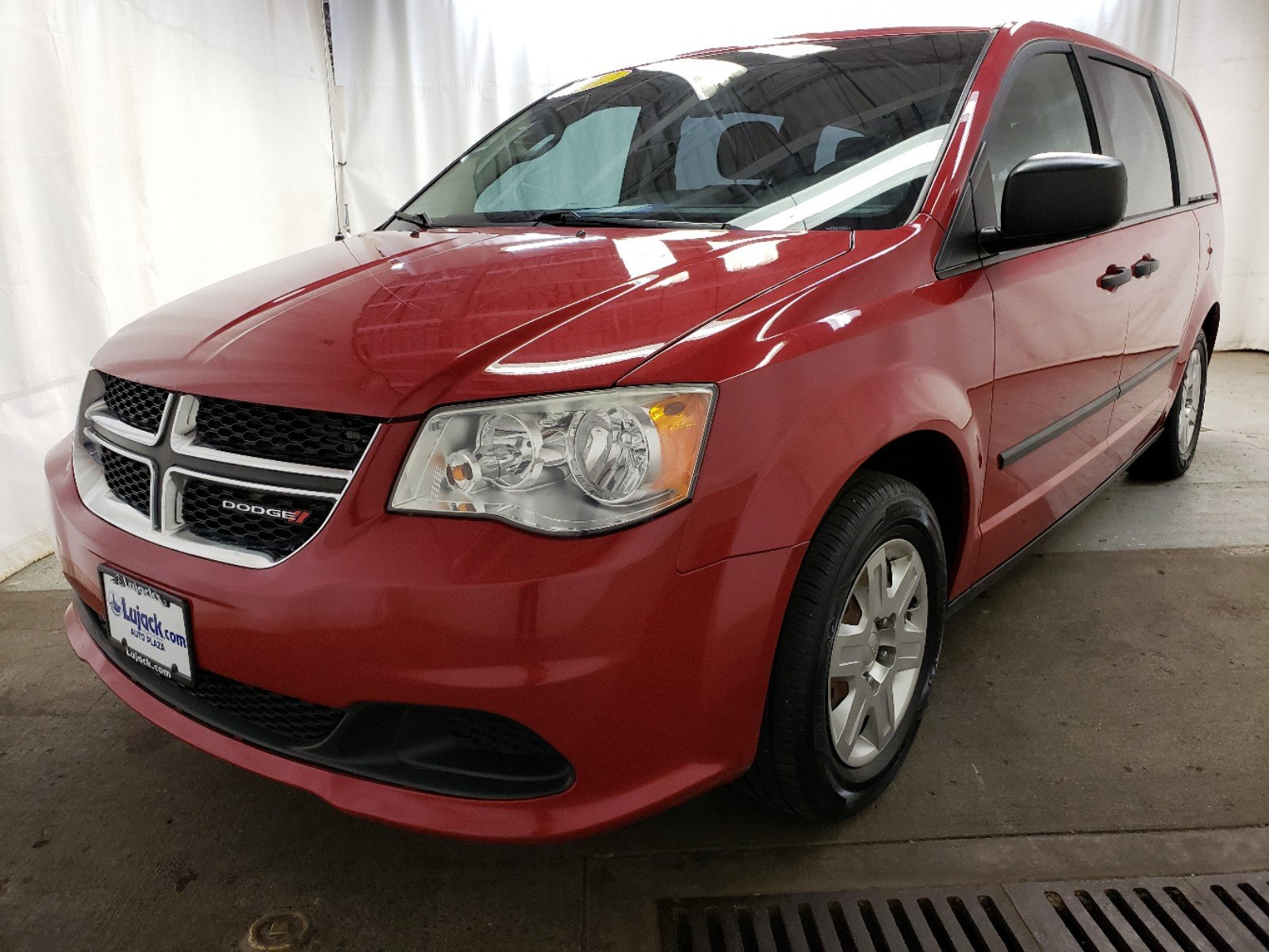 Pre-Owned 2012 Dodge Grand Caravan American Value Pkg